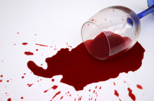 glass or red wine spilled on the floor